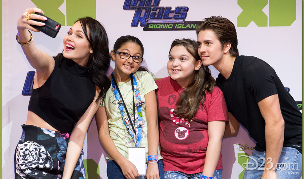 photo of Four Guests taking a selfie at the Lab Rats: Bionic Island exhibit of D23 EXPO 2015