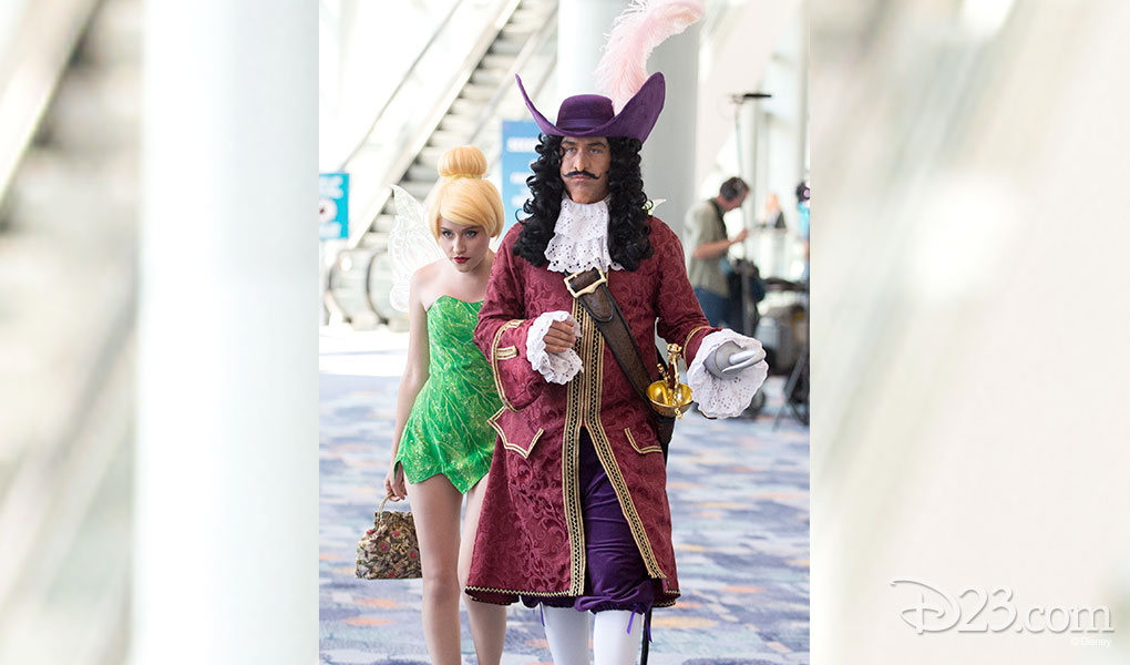 photo of Guests Dressed as Tinker Bell and Captain Hook crossing lobby at D23 EXPO 2015