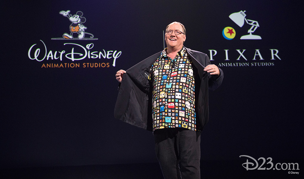 photo of John Lasseter holding his jacket open to show off his Custom-Made Movie Themed Hawaiian Shirt