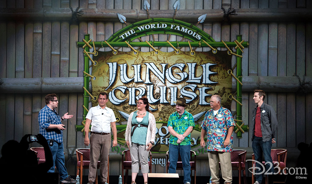 group on-stage photo of Kevin Lively, Alexander Williams, Kelly Small, Brandon Kleyla, Randy Grant, Brian Thomas in front of Jungle Cruise banner