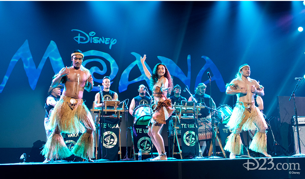 photo of musicians, singers, dancers in Te Vaka music group performing on stage led by singer-songwriter Opetaia Foai at D23 EXPO 2015