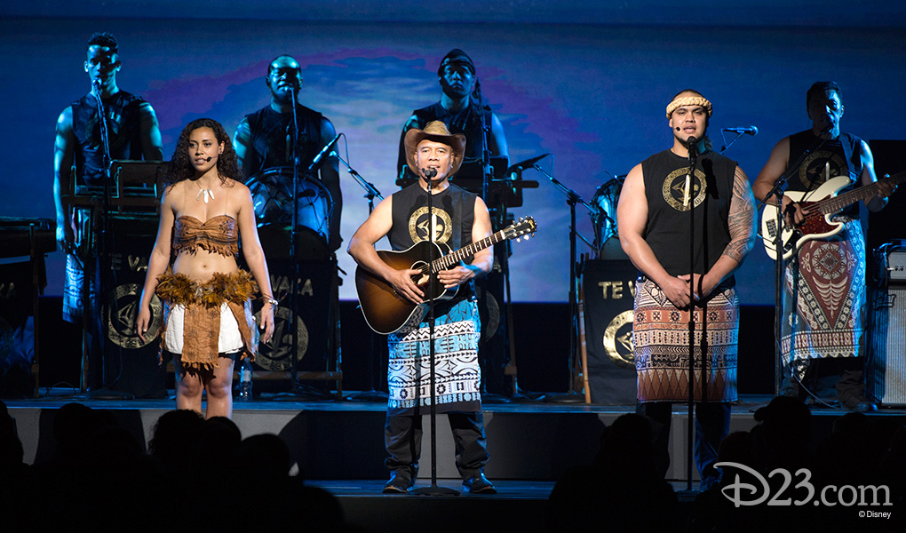 photo of musicians, singers, dancers in Te Vaka music group performing on stage led by singer-songwriter Opetaia Foai