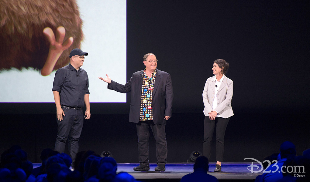 photo of John Lasseter introducing Peter Sohn and Denise Ream on stage