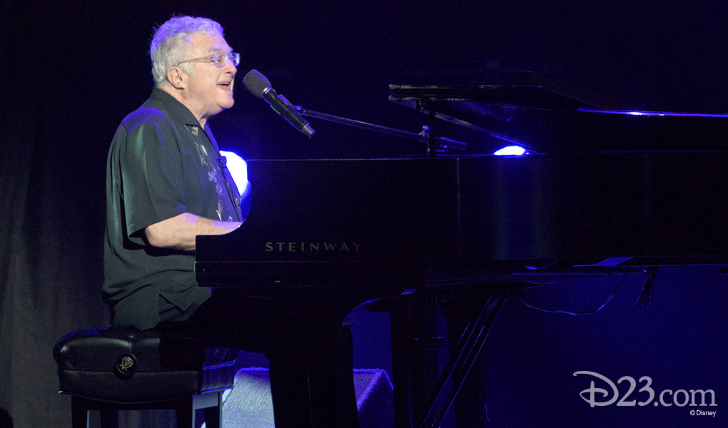 """photo of Randy Newman seated at Steinway piano playing and singing """"You Got a Friend in Me"""" from Toy Story"""