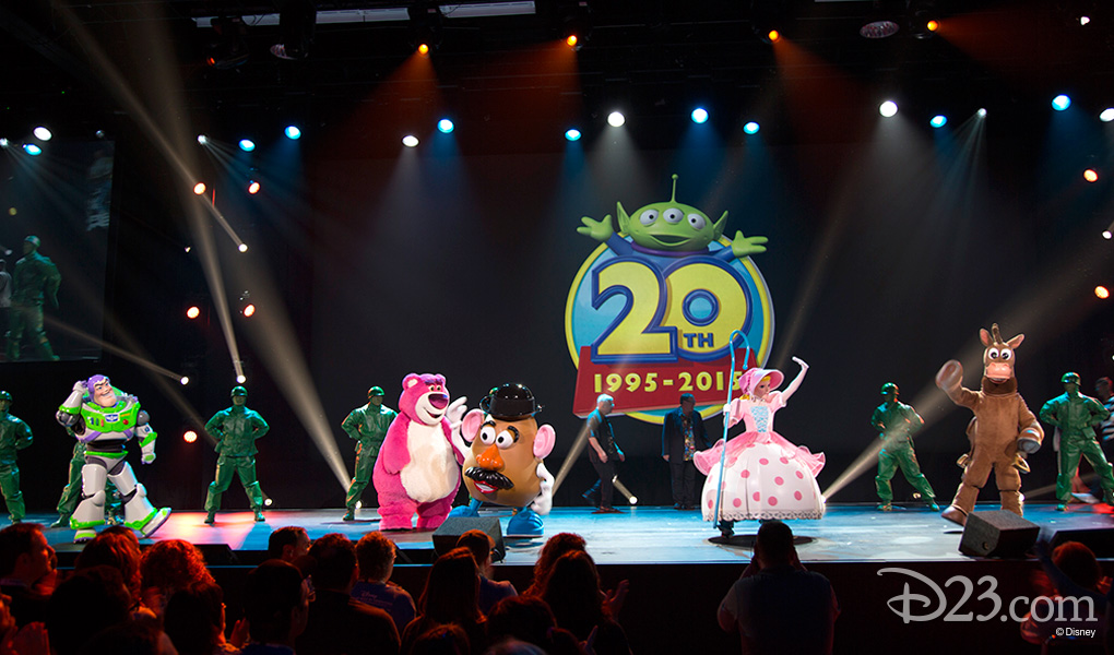 photo of stage filled with Toy Story Characters including Buzz Lightyear, Mr. Potato Head, Bo Peep, Bullseye the horse, and many Green Army Men