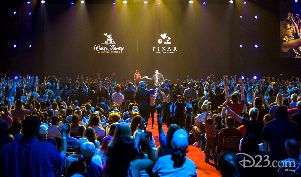 photo of audience cheering John Lasseter on stage at D23 EXPO 2015