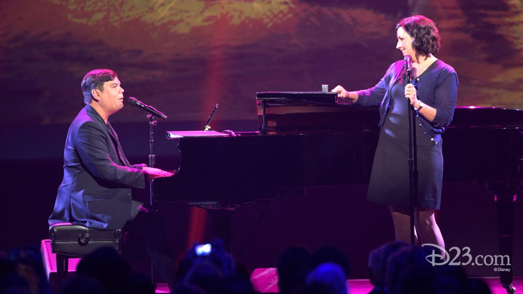 photo of Bobby Lopez and Kristen Anderson-Lopez singing, playing piano