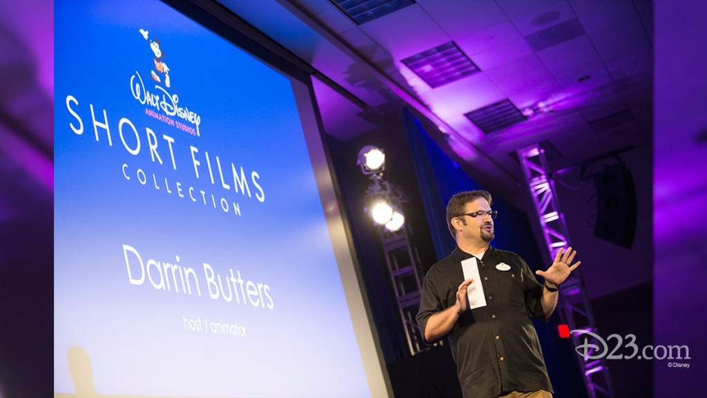 photo of Darrin Butters of Walt Disney Animation Studios onstage hosting Short Films Collection presentation at D23 EXPO 2015
