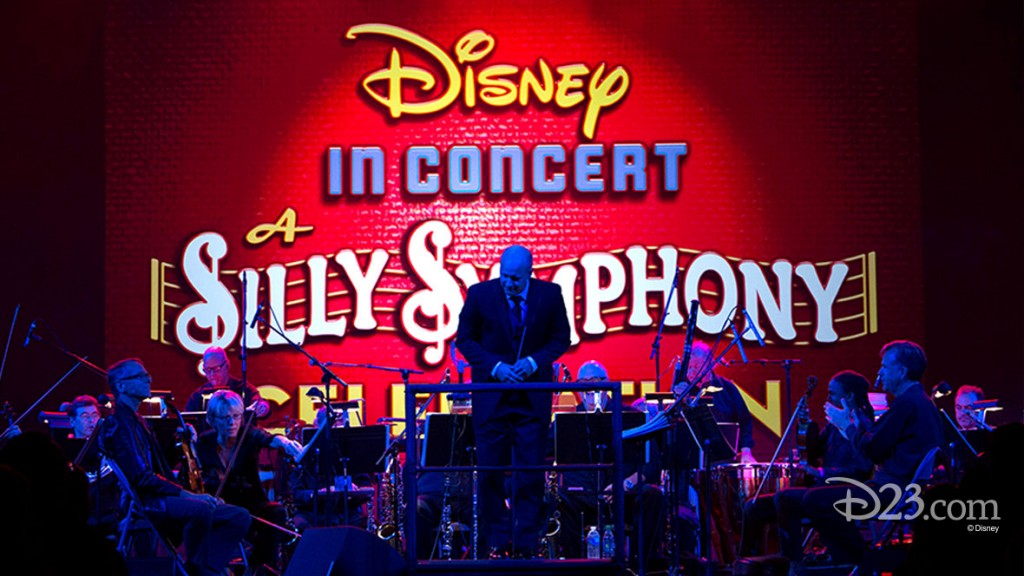 photo of Silly Symphony orchestra on stage  beneath a banner Disney in concert Silly Symphony