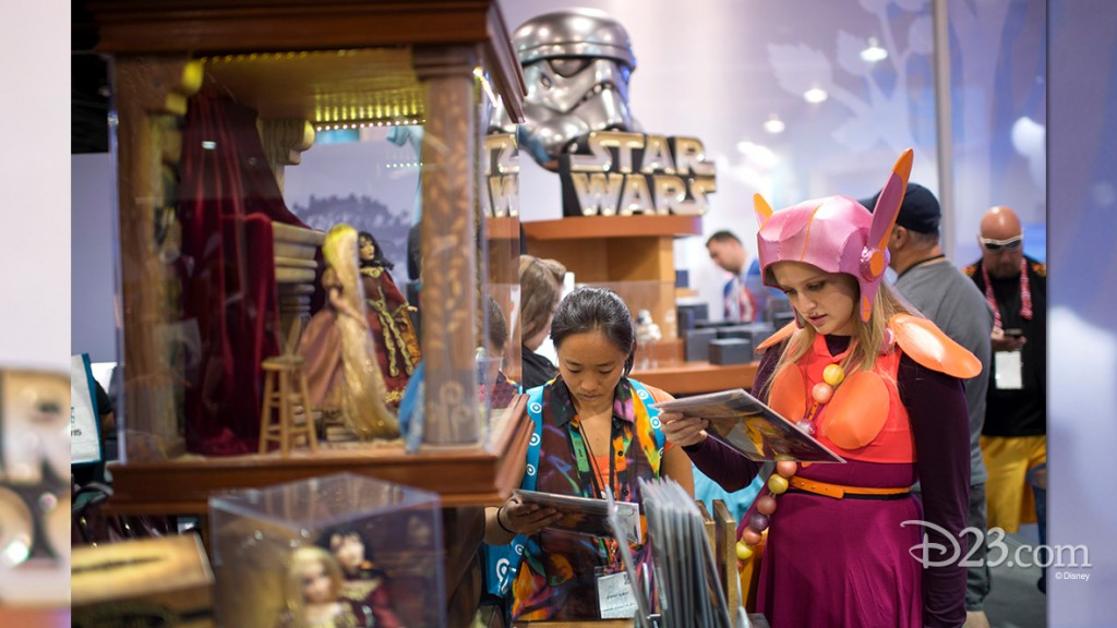 photo of two brightly costumed girls inspecting merchandise at the store
