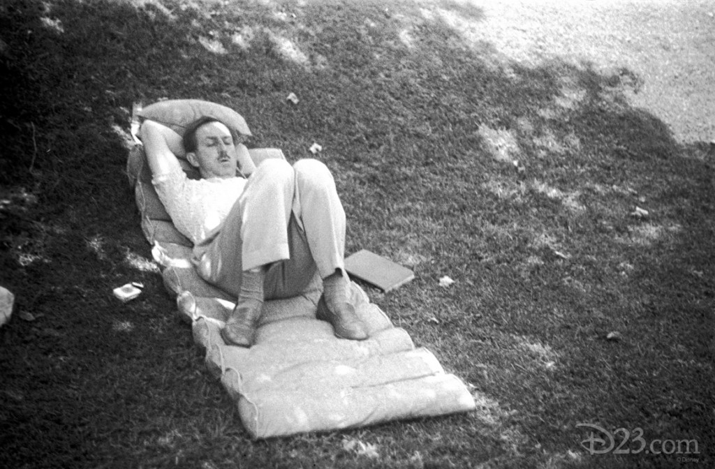 Walt sleeping in the shade on the lawn of his Woking Way home on a state-of-the-art '40-s cushion—a book at his side.
