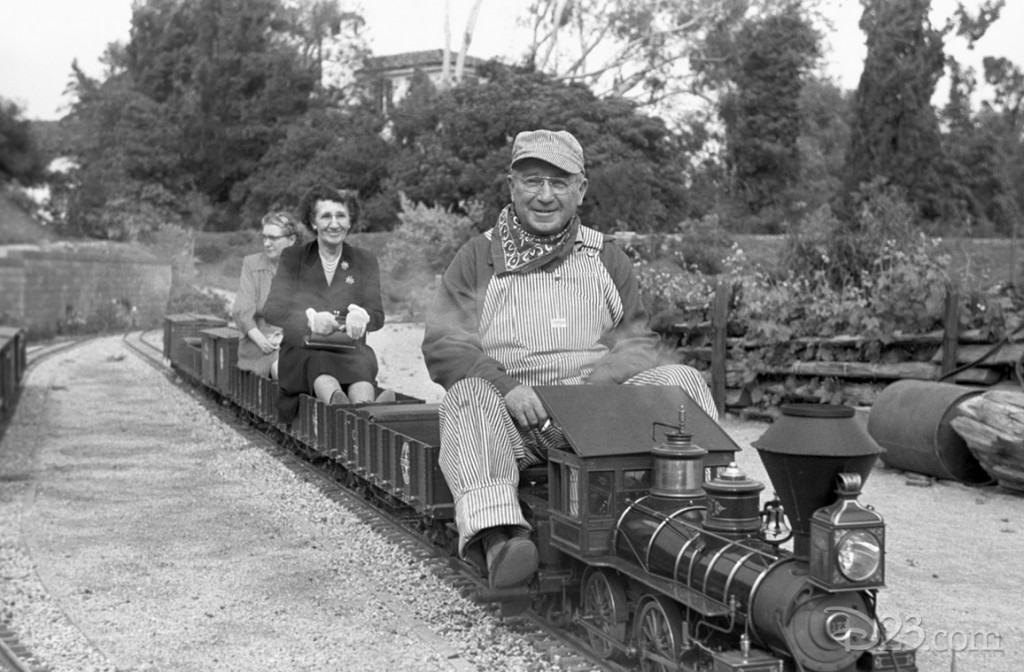 Walt's friends enjoying a ride on the <i>Carolwood Pacific</i>, the 1/8-scale model railroad he created for the back yard of his Carolwood home.