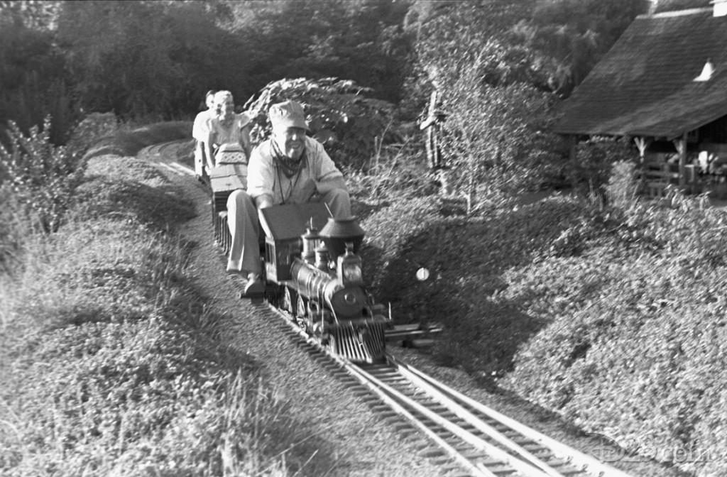 One of Walt's first Imagineers, Harper Goff—a fellow model train enthusiast—seen behind the Lilly Belle steam engine as it powers the <i>Carolwood Pacific</i> on another lap around Walt's Carolwood Drive home.