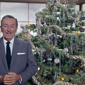 Walt Disney with a Christmas tree
