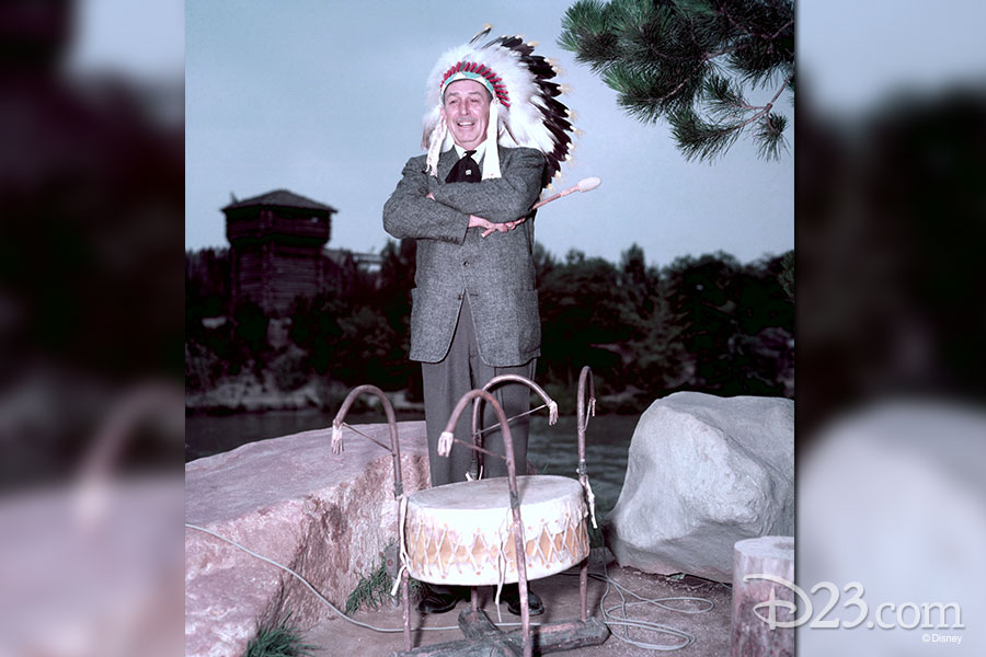 Walt Disney wearing an indian headdress.