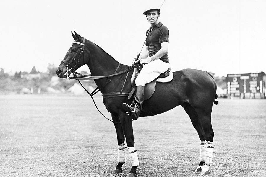 Walt Disney sitting on his polo pony.
