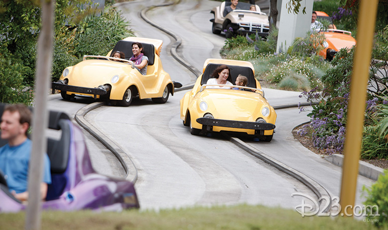 Guests driving Autopia cars