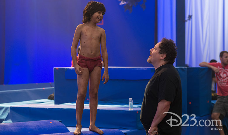 Neel Sethi and Jon Favreau on set
