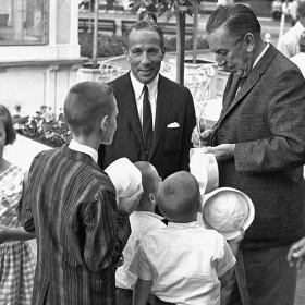 Walt Disney signing autographs at Disneyland