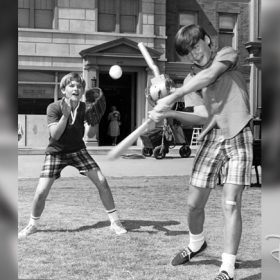 Kurt Russell playing baseball