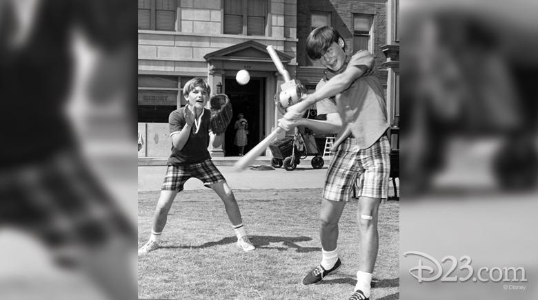 Kurt Russell playing baseball