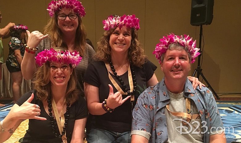 D23 Members showing off their kukui nut bracelets and Hawaiian lei crowns