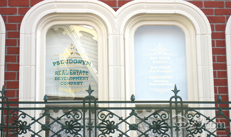 The Main Street, U.S.A. window representing the Pseudonym Real Estate Development Company with its phantom leaders, Roy Davis, Bob Price, and Bob Foster.