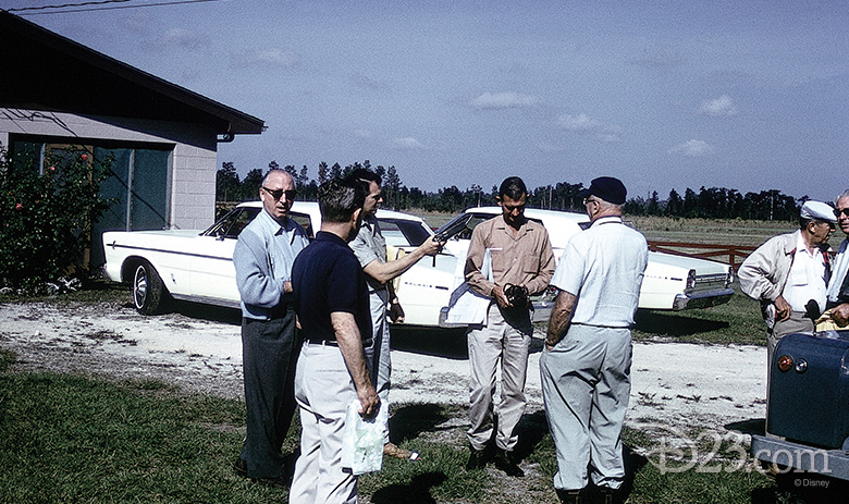 Roy Disney, Joe Potter, Bob Foster, Bill Hart, Joe Fowler, and Walt gather at the Smiths' house in 1965. (Man to the right of Walt is unidentified).