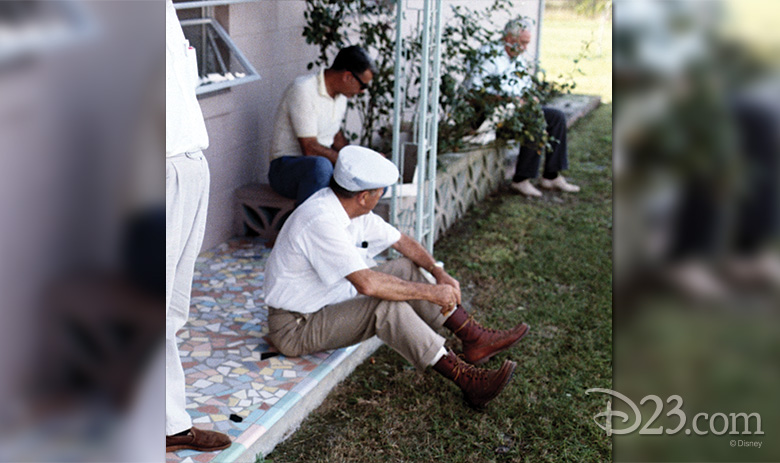 Walt rests on Phil's future front porch while exploring the new Disney property in 1965.