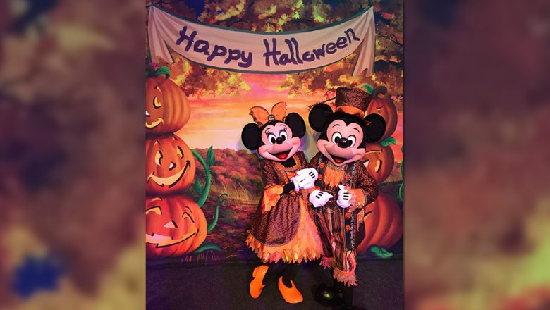 Mickey and Minnie in Halloween outfits