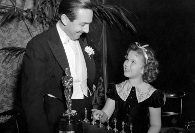 Walt receiving an Academy Award for Snow White and the Seven Dwarfs