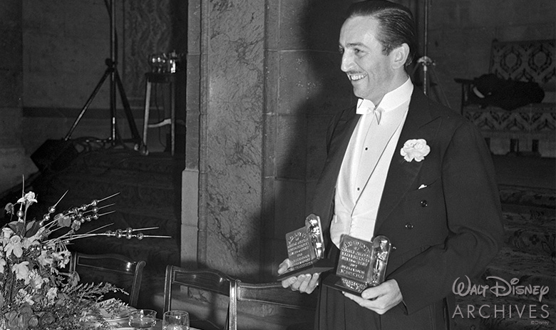 Walt holding two Academy Awards