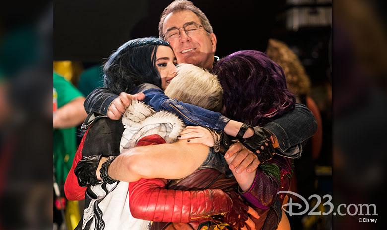 Kenny Ortega and the Descendants 2 cast hugging