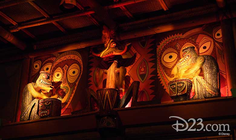 carved drummer statues inside the Enchanted Tiki Room