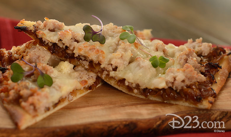 Pizza Toscana: Rustic Italian Flatbread with Sweet Sausage, Caramelized Onion, Mozzarella, Asiago, and Parmesan Cheeses