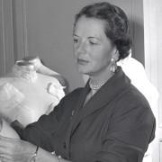 Renié measuring a female dress form.